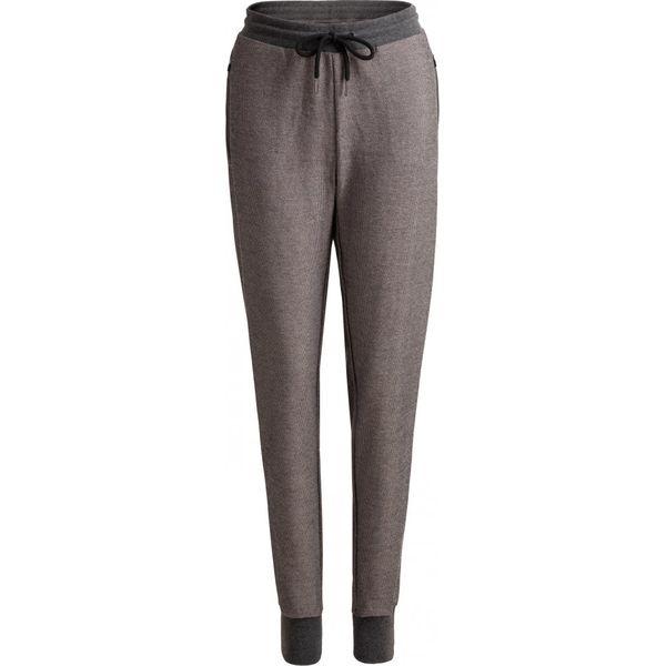 Spodnie dresowe damskie SPDD602 - średni szary melanż - Outhorn. Szare spodnie dresowe damskie marki Outhorn, melanż, z dresówki. W wyprzedaży za 79,99 zł.