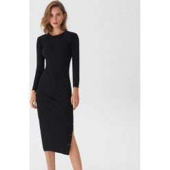 Sukienka z zapięciem na napy - Czarny. Czarne sukienki na komunię marki Reserved, l, z dekoltem na plecach. Za 79,99 zł.