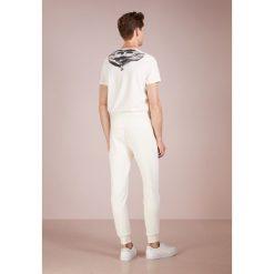 C.P. Company Spodnie treningowe gauze white. Białe spodnie dresowe męskie C.P. Company, z bawełny. Za 589,00 zł.