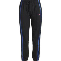 Fenty PUMA by Rihanna TEARAWAY TRACK PANT Spodnie treningowe puma black. Czarne spodnie dresowe damskie Fenty PUMA by Rihanna, xxs, z poliesteru. W wyprzedaży za 439,45 zł.