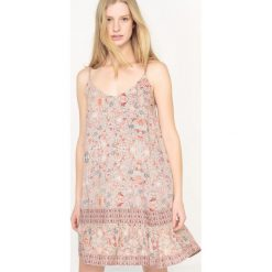 Sukienki hiszpanki: Sukienka w kwiaty na cienkich ramiączkach