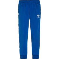 Adidas Originals PANTS Spodnie treningowe blue. Niebieskie spodnie chłopięce adidas Originals, z jeansu. Za 169,00 zł.