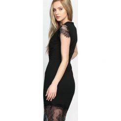 Sukienki: Czarna Sukienka Most Curious