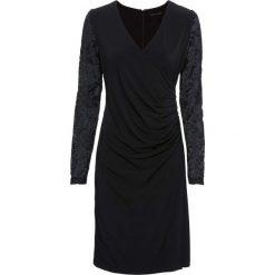 Sukienka bonprix czarny. Czarne sukienki balowe marki bonprix, w koronkowe wzory, z koronki, z kopertowym dekoltem, kopertowe. Za 99,99 zł.
