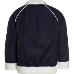 GAP BABY BOY Kurtka Bomber navy uniform. Niebieskie kurtki chłopięce przeciwdeszczowe GAP, z materiału. Za 169,00 zł.