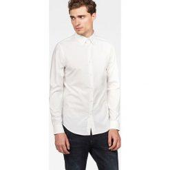 G-Star Raw - Koszula Core. Szare koszule męskie na spinki G-Star RAW, m, z bawełny, z klasycznym kołnierzykiem, z długim rękawem. W wyprzedaży za 199,90 zł.