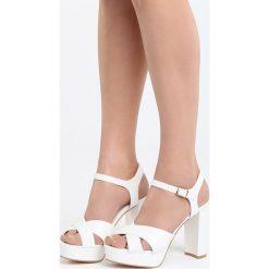 Białe Sandały We Were Here. Białe sandały damskie na słupku marki Born2be, z materiału, na wysokim obcasie. Za 44,99 zł.