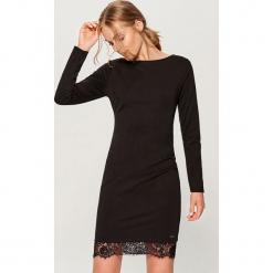 Sukienka z koronką - Czarny. Czarne sukienki koronkowe marki Mohito, l, w koronkowe wzory. Za 79,99 zł.