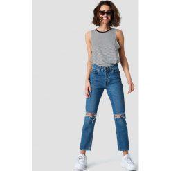 Rut&Circle Jeansy z rozdarciami Louisa - Blue. Zielone jeansy damskie marki Rut&Circle, z dzianiny, z okrągłym kołnierzem. Za 202,95 zł.