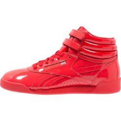 Reebok Classic Tenisówki i Trampki wysokie red. Czerwone trampki chłopięce marki Reebok Classic, z materiału. W wyprzedaży za 224,10 zł.