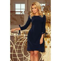 Carmen Sukienka z kokardkami - GRANATOWA. Niebieskie sukienki balowe numoco, s, z kołnierzem typu carmen, rozkloszowane. Za 159,99 zł.