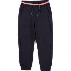Spodnie. Czarne chinosy chłopięce NOISE, z bawełny. Za 49,90 zł.