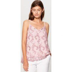 Odzież damska: Zmysłowy top z aplikacją gold label - Różowy
