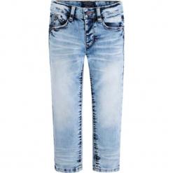 Spodnie w kolorze jasnoniebieskim. Różowe spodnie chłopięce marki Mayoral, z bawełny, z okrągłym kołnierzem. W wyprzedaży za 64,95 zł.
