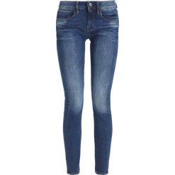 GStar 3301 DECONST MID SKINNY Jeans Skinny Fit yzzi stretch. Niebieskie rurki damskie G-Star. W wyprzedaży za 475,15 zł.
