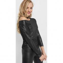 Koszulka z połyskiem. Czarne bluzki z odkrytymi ramionami marki KIPSTA, m, z elastanu, z długim rękawem, na fitness i siłownię. Za 69,99 zł.