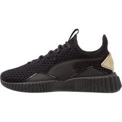 Puma DEFY VARSITY Obuwie treningowe black/metallic gold. Czarne buty sportowe damskie Puma, z materiału. Za 419,00 zł.