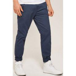 Chinosy męskie: Spodnie typu CHINO - Niebieski