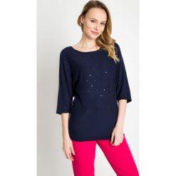 Granatowy sweter z nietoperzowymi rękawami QUIOSQUE. Niebieskie swetry klasyczne damskie marki QUIOSQUE, uniwersalny, ze splotem, z okrągłym kołnierzem. W wyprzedaży za 49,99 zł.