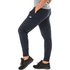 4f Spodnie dresowe damskie H4Z17-SPDD003 czarne r. L. Czarne spodnie sportowe damskie marki 4f, l, z dresówki. Za 109,36 zł.