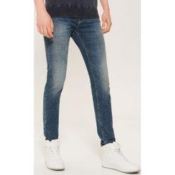 Jeansy skinny - Granatowy. Niebieskie jeansy męskie skinny marki House, z jeansu. Za 99,99 zł.