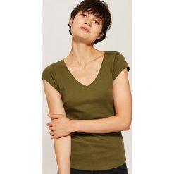 T-shirt basic - Zielony. Czarne t-shirty damskie marki KIPSTA, z poliesteru, do piłki nożnej. Za 19,99 zł.