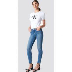 Calvin Klein Jeansy Mid Rise Skinny West - Blue. Niebieskie jeansy damskie Calvin Klein, z denimu. Za 546,95 zł.