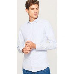 Koszula slim fit w paski - Niebieski. Niebieskie koszule męskie slim Reserved, l, w paski. W wyprzedaży za 49,99 zł.