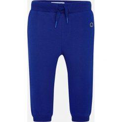 Mayoral - Spodnie dziecięce 68-98 cm. Niebieskie spodnie chłopięce marki Mayoral, z aplikacjami, z bawełny. Za 49,90 zł.