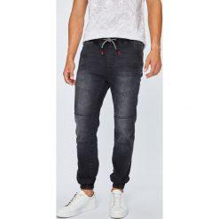 Medicine - Jeansy Monumental. Czarne jeansy męskie z dziurami marki MEDICINE. Za 149,90 zł.