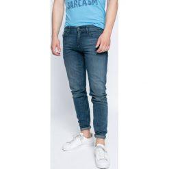 Calvin Klein Jeans - Jeansy Typhoon. Niebieskie jeansy męskie skinny marki Calvin Klein Jeans, z bawełny. W wyprzedaży za 379,90 zł.