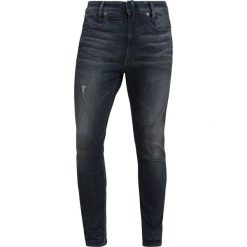 GStar DSTAQ 3D SKINNY Jeans Skinny Fit dark aged antic destroy. Niebieskie rurki męskie marki G-Star, z bawełny. Za 749,00 zł.