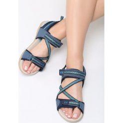 Niebieskie Sandały Juniper. Niebieskie sandały damskie marki Born2be, z materiału, na obcasie. Za 79,99 zł.