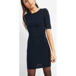 Dopasowana sukienka z dzianiny. Brązowe sukienki dzianinowe marki Orsay, s. Za 79,99 zł.