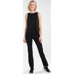 Röhnisch PLEATED CROPPED Koszulka sportowa black. Czarne t-shirty damskie Röhnisch, xl, z poliesteru. Za 169,00 zł.