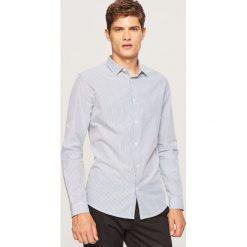 Koszula slim fit w paski - Granatowy. Niebieskie koszule męskie slim Reserved, l, w paski. W wyprzedaży za 49,99 zł.