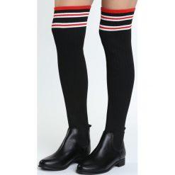 Czarne Kozaki Verity. Czarne buty zimowe damskie marki Born2be, na płaskiej podeszwie. Za 149,99 zł.