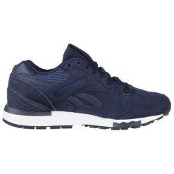 Buty sportowe w kolorze granatowym. Brązowe buty sportowe męskie marki Reebok, z materiału. W wyprzedaży za 249,95 zł.