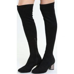 Czarne Kozaki Electric. Czarne buty zimowe damskie marki Born2be, na niskim obcasie, na słupku. Za 159,99 zł.