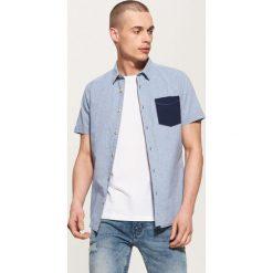 Koszula z kontrastową kieszonką - Niebieski. Niebieskie koszule męskie marki bonprix, m, melanż, z dżerseju. Za 69,99 zł.
