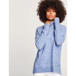 Miękki sweter ze stójką - Niebieski. Niebieskie swetry klasyczne damskie marki ARTENGO, z elastanu, ze stójką. Za 119,99 zł.