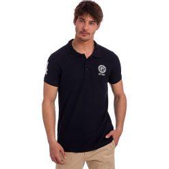 Koszulka polo w kolorze granatowym. Niebieskie topy sportowe damskie Polo Club, z haftami, z bawełny, z krótkim rękawem. W wyprzedaży za 84,95 zł.