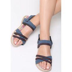 Niebieskie Sandały Garden Of Starlight. Niebieskie sandały damskie marki Born2be, z materiału, na obcasie. Za 79,99 zł.