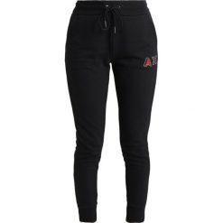 Bryczesy damskie: Armani Exchange Spodnie treningowe black