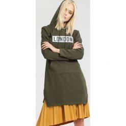 Bluzy damskie: Ciemnozielona Bluza Coextending