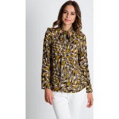 Bluzki asymetryczne: Bluzka we wzory z długim rękawem wiązana przy szyi BIALCON