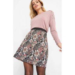 Żakardowa spódnica mini. Czarne minispódniczki Orsay, w jednolite wzory, z bawełny, trapezowe. Za 99,99 zł.