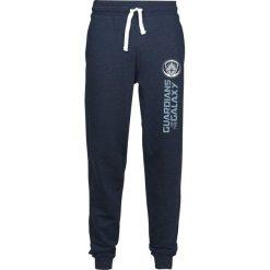 Guardians Of The Galaxy Logo Spodnie dresowe odcienie ciemnoniebieskiego. Niebieskie spodnie dresowe męskie Guardians Of The Galaxy, z nadrukiem, z dresówki. Za 99,90 zł.