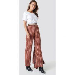 Spodnie damskie: NA-KD Trend Spodnie z nadrukiem - Brown,Orange,Multicolor