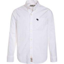 Abercrombie & Fitch CLASSIC STRETCH Koszula white solid. Niebieskie bluzki dziewczęce bawełniane marki Abercrombie & Fitch. Za 179,00 zł.